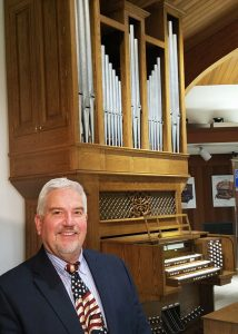 Jeff Kirk and digital & pipe combination organ